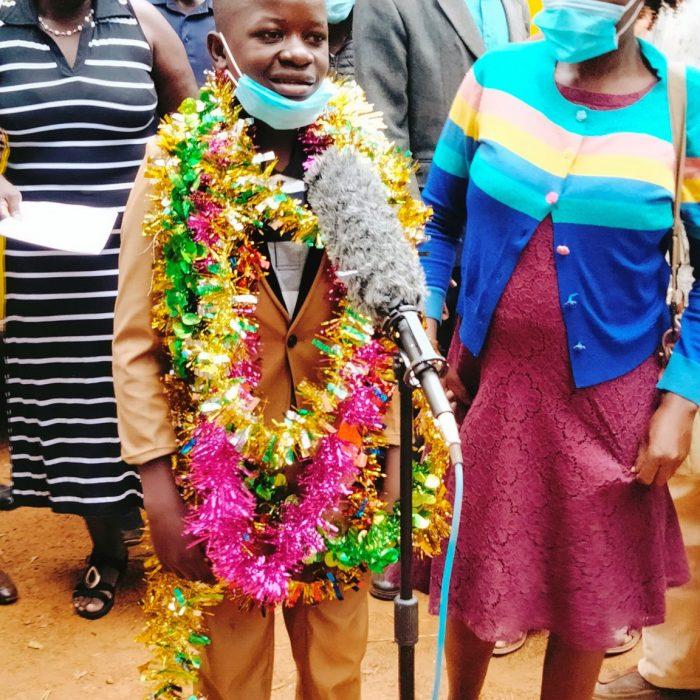 Samuel Wanyonyi addressing the media alongside Madam Lydia Namisi (left) and his mum Irine Makheti at Nzoia Sugar Primary School.
